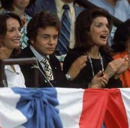 With her sister and nephew, former First Lady Jackie Kennedy Onassis joins the convention cheering at the 1976 National Democratic Convention. (Getty)