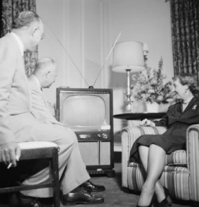 In their hotel suite, Ike and Mamie and his brother Milton pose as if watching TV - even though the set isn't turned on. Ike and Mamie were the first White House TV couple. (TJ O'Halloran/Life)
