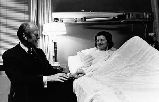 Betty Ford in Walter Reed Hospital, where her breast cancer mastectomy was performed, smiling at the President. (GRFPL)