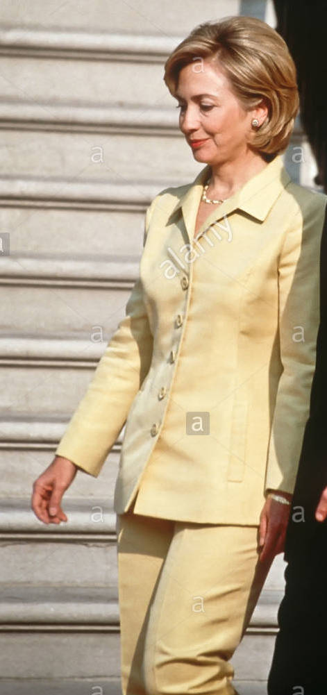 Hillary Clinton began wearing what would become her signature clothing choice - the colored pants suit, as early as 1998 while serving as First Lady. (Alamy)