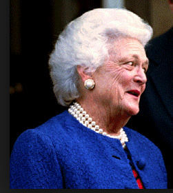 "Barbara Bush in a ""Bush Blue"" suit with pearls. (Getty)"