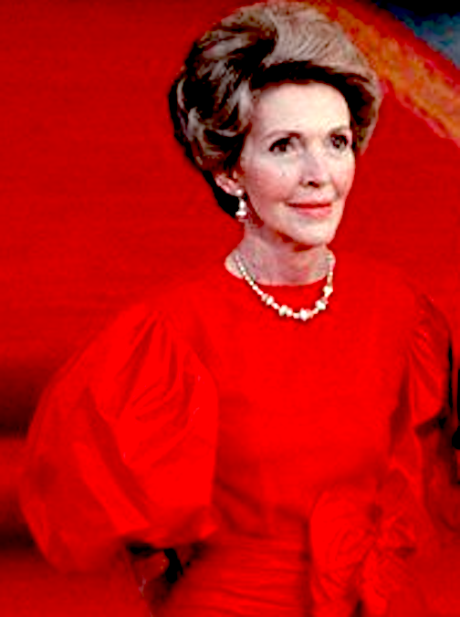"Nancy Reagan in her signature bright ""Reagan Red,"" worn in an evening gown for a state dinner. (RRPL)"