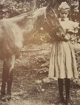 Young Eleanor Roosevelt with a horse; she was a skilled and lifelong rider. (FDRL)