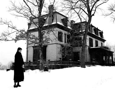 In later years, Eleanor Roosevelt stands outside the Tivoli, New York home of her maternal grandmother, where she spent her adolescence. (FDRL)