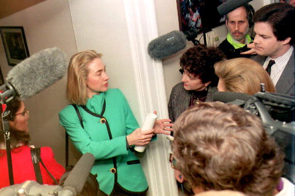 Hillary Clinton speaks to reporters in the hallway outside of her West Wing office. (Getty)