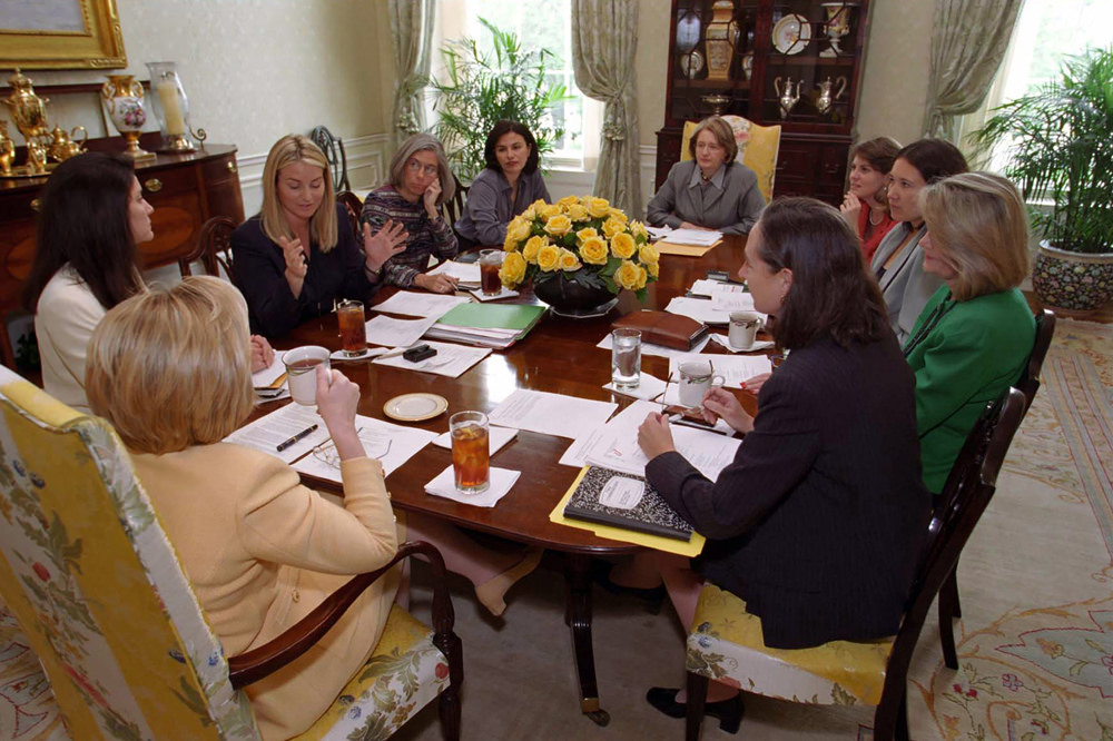 "Hillary Clinton conducting a staff meeting with members of ""Hillaryland."" (firstladies.org)"