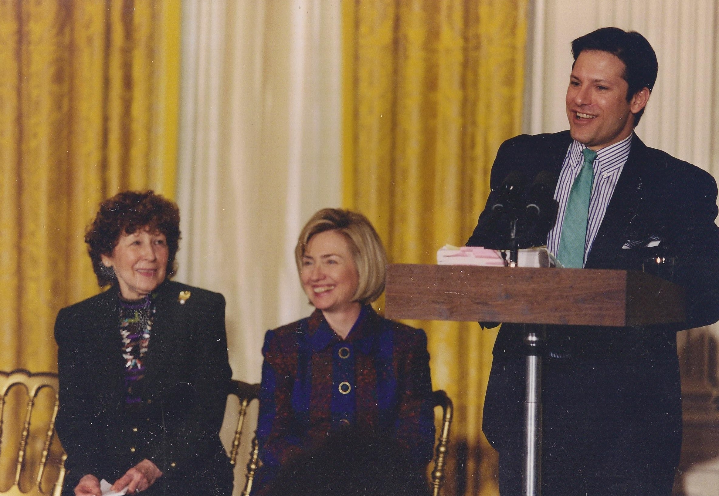 Hillary Clinton with Mary Regula, founder of the National First Ladies' Library at the East Room launch of the NFLL website, its historian Carl Anthony at the lectern. (WJCPL)