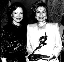 In December 1992, Hillary Clinton presented Rosalynn Carter with a humanitarian award named after Eleanor Roosevelt. (Washington Post)