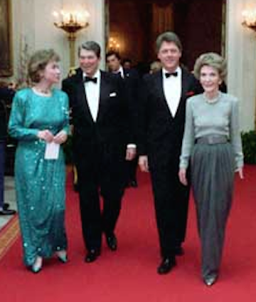 Ronald and Nancy Reagan walk down the White House Cross Hall with then-Governor Bill Clinton and Hillary Clinton, 1982. (RRPL)