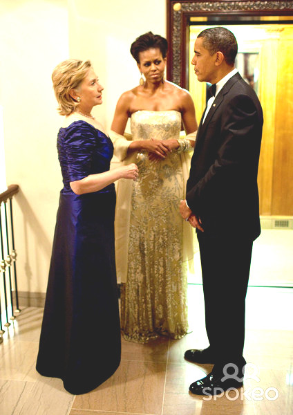 President Barack Obama, First Lady Michelle Obama and Secretary of State Hillary Clinton in a White House vestibule during a state dinner. (WH)