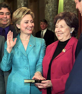 While still the incumbent First Lady, Hillary Clinton took the oath of office as United States Senator in January 1, 2001, her mother holding the Bible during the Senate ceremony. (Getty)
