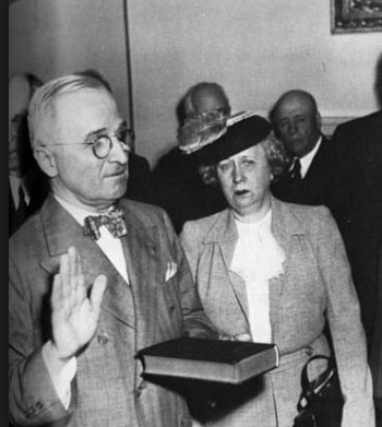 Bess Truman witnessing the swearing-in of her husband as president in the White House Cabinet Room, following the death of President Roosevelt. (pinterest.com)