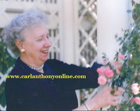 Mrs. Truman admiring some of the prized roses from her flower garden at home. (carlanthonyonline.com)