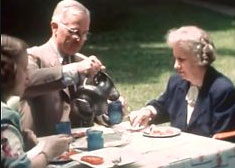 Harry, Bess and Margaret Truman breakfasting together on their back lawn, home in Missouri. (HSTL)